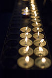 Wax candlelights giving light in the dark Royalty Free Stock Photos