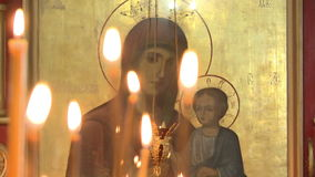 Wax candles in the Church burn. On the background of the icon.An Orthodox Church stock footage