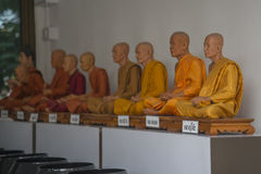 The wax copy of deceased Buddhist monks. Under the statues hanging signs with the names of monks stock photos