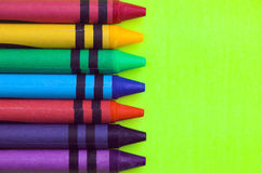 Wax Crayons. On yellow background Royalty Free Stock Image