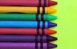 Wax Crayons. On yellow background Stock Photos
