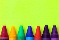 Wax Crayons. On yellow background Stock Image