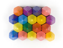 Wax crayons. Hexagon wax crayons, stacked on white background Royalty Free Stock Photos