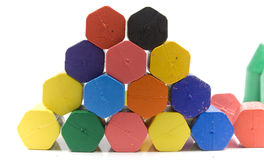 Wax crayons. Hexagon wax crayons, stacked on white background stock photo