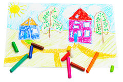 Wax crayons and a children's drawing. Royalty Free Stock Photo