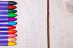 Wax crayons on wood table Stock Photography