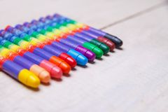 Wax crayons on wood table Royalty Free Stock Photography