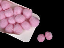Wax ear plugs in pink cotton wool - isolated Stock Photography