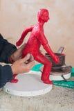 Wax figure. Artist working on a wax figure in his studio Stock Photo