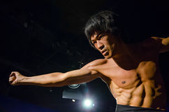 The wax figure of Bruce Lee in Madame Tussauds Singapore. Singapore - September 15,2015 : The wax figure of Bruce Lee in Madame Tussauds Singapore royalty free stock photography