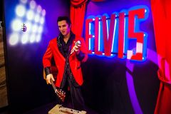 Wax figure of Elvis Presley singer in Madame Tussauds Wax museum in Amsterdam, Netherlands. Amsterdam, Netherlands - March, 2017: Wax figure of Elvis Presley royalty free stock image