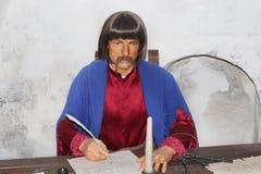 Wax figure of old clerk in museum of Baturin. Portrait of clerk with pen in his hand Stock Photos