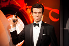 Wax figure of Pierce Brosnan as James Bond 007 agent in Madame Tussauds Wax museum in Amsterdam, Netherlands Royalty Free Stock Photo