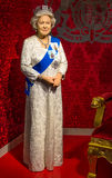 The wax figure of Queen Elizabeth II in Madame Tussauds Singapore. Royalty Free Stock Image