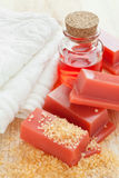 Wax for hair removal, towel and roses oil Royalty Free Stock Photos