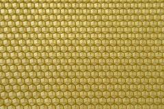 Honeycomb background. Golden wax honeycomb hexagonal cells stock photo