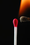 Wax match on fire Stock Photos