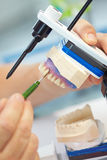 Wax modeling on an articulator royalty free stock image