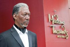 Wax Morgan Freeman. A life-like statue of Morgan Freeman in front of Madame Tussauds Wax Museum on 42nd Street in New York City royalty free stock images