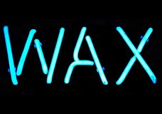 Wax Neon Sign. Blue neon sign with the word Wax Stock Photos