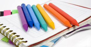 Wax Pencils On Notebook Stock Photos