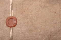 Wax seal. On sackcloth material Royalty Free Stock Images