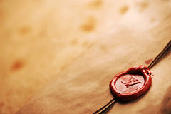 Wax seal on a grunge paper Royalty Free Stock Photos