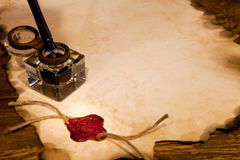 Wax seal and ink. Old ink pot on a parchment scroll with wax seal stock photos