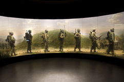 Wax soldiers marching in Korean war with painting stock images