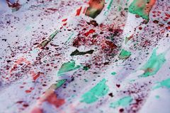 Wax and sparkling red green pink vivid lights, waxy winter background. Wax and red sparkling red pink gray orange green colorful lights, waxy background in Stock Photo