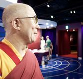 Wax statue of Dalai lama at Madame tussauds London. Wax statue in Madame Tussaud tokyo Royalty Free Stock Images