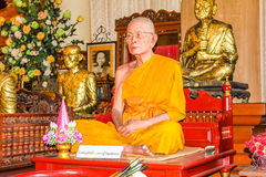 Wax statue of monk in Buddhist temple Stock Image