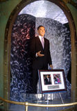 Wax statue of President Barak Obama. Wax statue of the 44th President Barak Obama reaching out his hand on display with picture frame of two photographs from Stock Photo