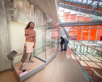 Wax statues of primitive man at the science museum of Trento, It royalty free stock photography