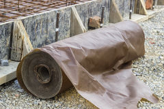 Waxed paper underlayment for concrete slab installation Stock Images