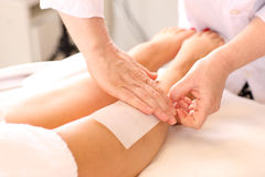 Waxing. Legs being waxed at a beauty clinic Stock Image