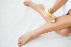 Waxing. Beautician Waxing Woman`s Leg In Spa Salon royalty free stock image