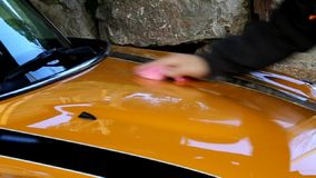 Waxing the car stock footage