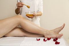 Waxing. Close up waxing in by a beautician in a spa center Stock Photo