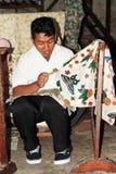 Waxing colors on batik Stock Photo