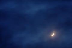 Waxing crescent moon on sky Stock Photos