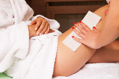 Waxing legs Stock Images