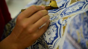 Waxing the patterns on the textile for batik stock video footage
