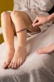 Waxing treatment at spa Stock Photo