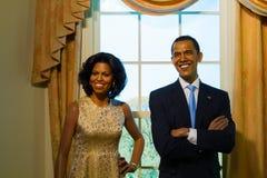Waxwork av Barack Obama och hans fru Arkivfoton