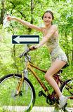 That Way!. Girl on the bike pointing direction royalty free stock photos