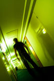 This is the way 2. Man walking on a long hallway stock photo
