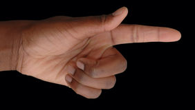 This way. African American hand pointing the way on black background Royalty Free Stock Photos