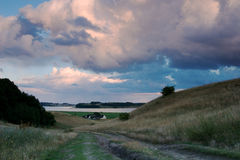 The way. Landscapes with meadow, a way hills and cloudy sky Stock Photography