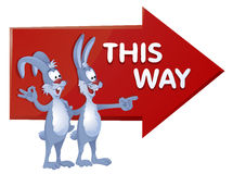 This way. Big red arrow. Rabbits show the direction. Royalty Free Stock Image